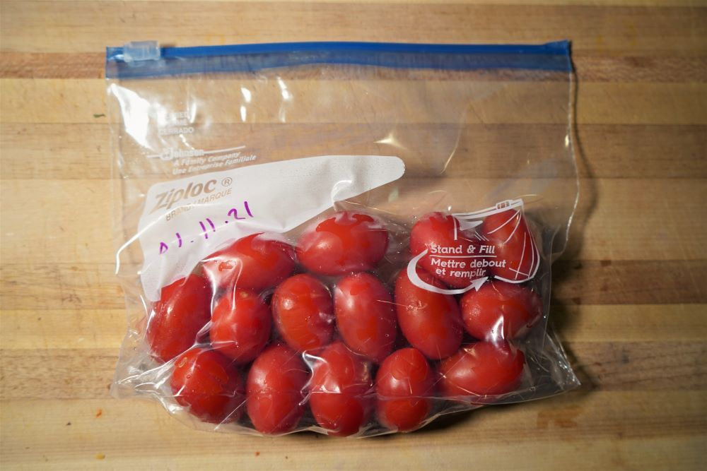 Frozen grape tomatoes in freezer bag